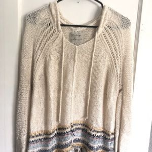 Knit cream hoodie with fringe on bottom